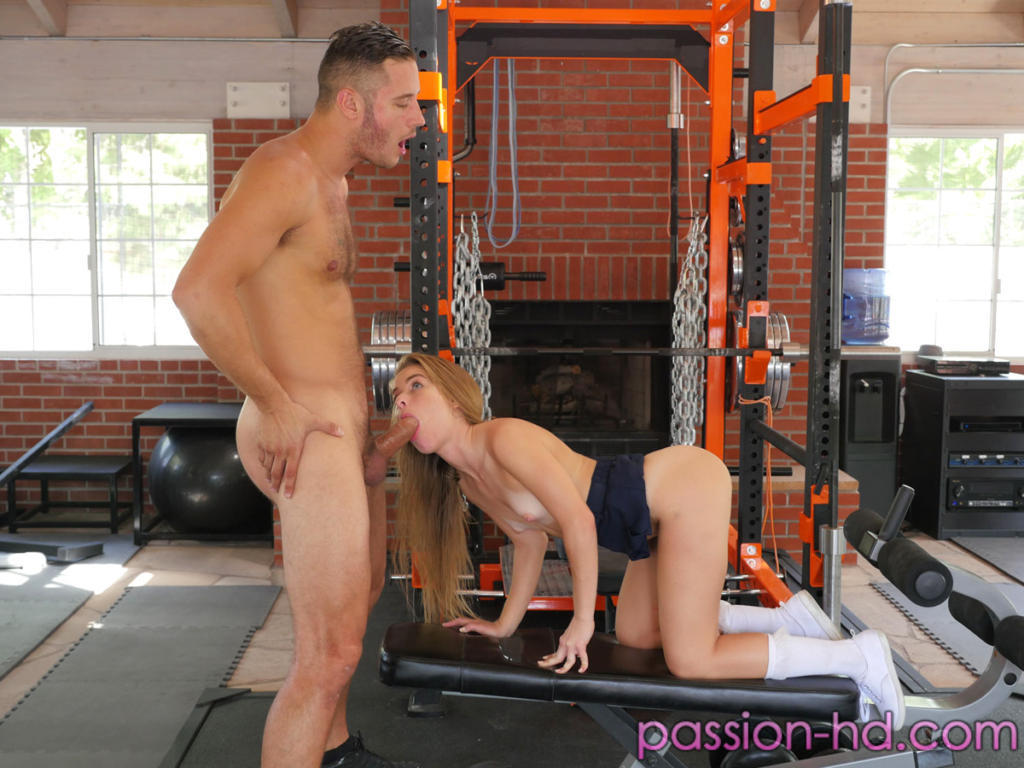 Sexy girls share a hard cock in this sexual gym workout session