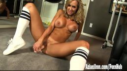 Brandi Love strips off her work out clothes in the gym then masturbates