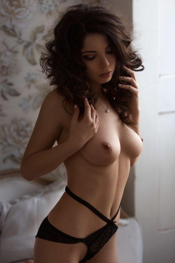 Christy lights candles and strips naked elegantly