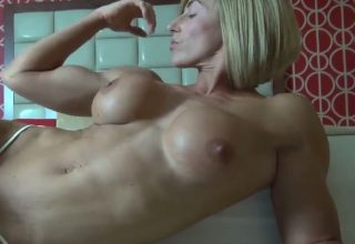 Nude Muscle Girl Bicep Flexing