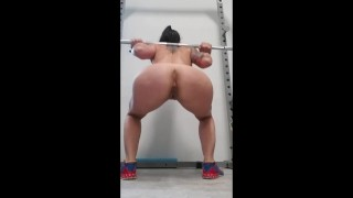 Fit Milf squatting in the gym naked.